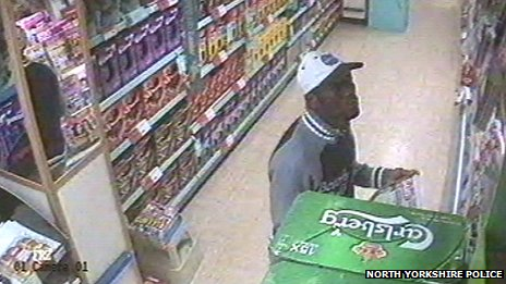 CCTV image of man in Co-op