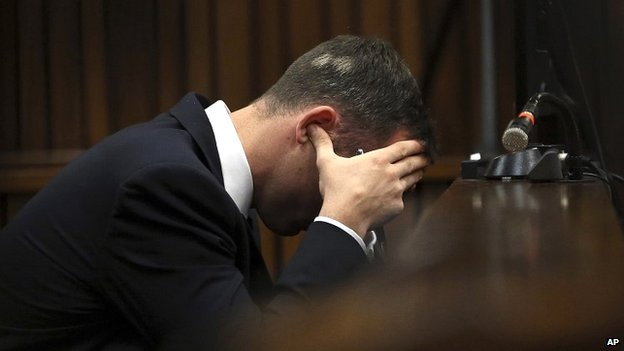 Oscar Pistorius sits with his fingers in his ears in the Pretoria courtroom