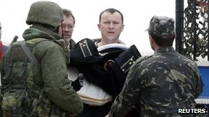 Man presumed to be a Ukrainian naval officer leaves Sevastopol base in Crimea