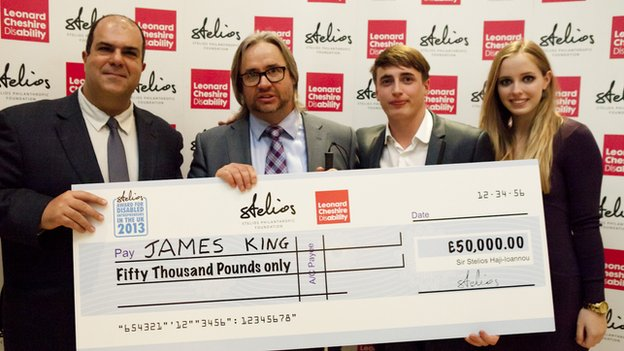 James King and his children receive cheque from Sir Stelios