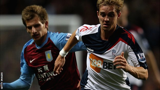 Stuart Holden (right) in action for Bolton