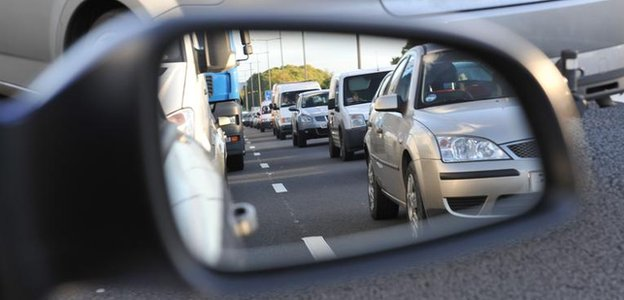 Traffic seen in wing mirror