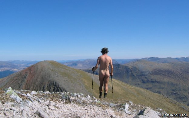 A naked man hiking