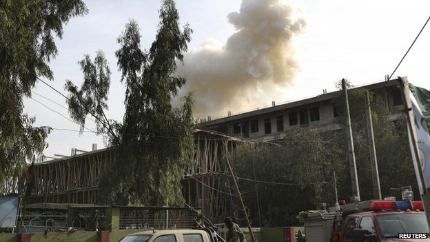 Smoke billows from a building after an attack on a police station in Jalalabad