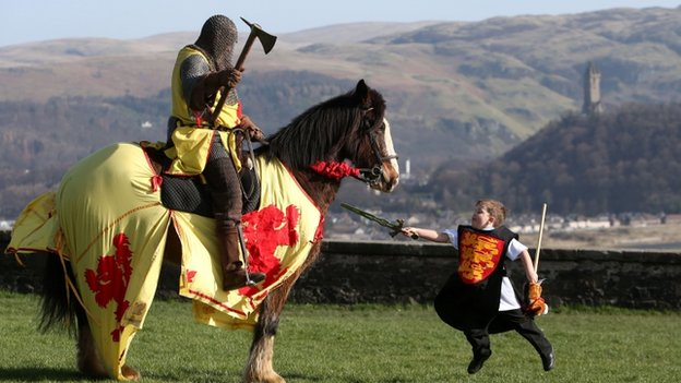 Sword-wielding child mimics attack on mounted knight