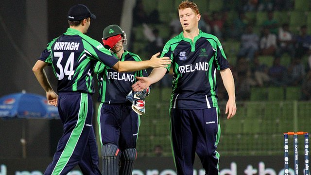 Tim Murtagh congratulates Kevin O'Brien after he takes a wicket against UAE