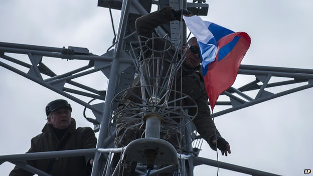 Pro-Russian forces hang up a Russian flag after seizing the Ukrainian corvette Khmelnitsky in Sevastopol, Crimea (March 20, 2014)
