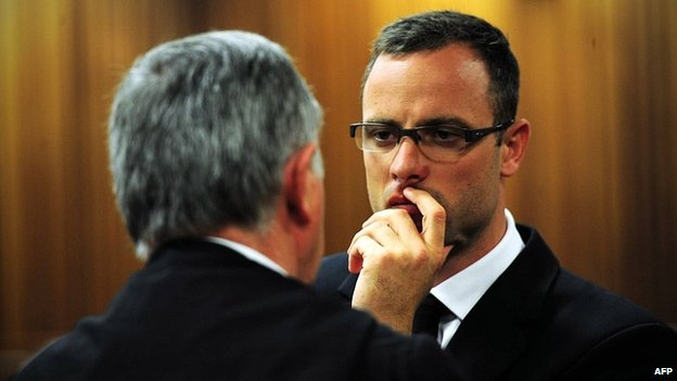 Oscar Pistorius consults his lawyer, Barry Roux, in the Pretoria courtroom