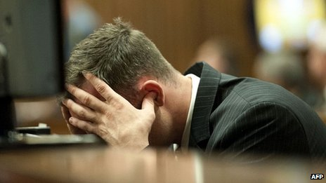 Oscar Pistorius puts his fingers in his ears during evidence in court
