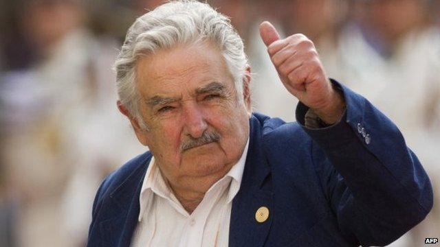 Uruguay's president Jose Mujica gives his thumb up at the press in Chile, on March 10, 2014