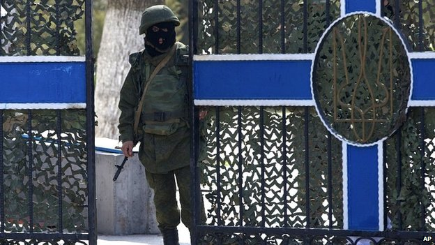 Pro-Russia soldier guards headquarters of Ukraine navy base in Crimea. 20 March 2014