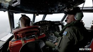 Royal Australian Air Force Flight Engineer Warrant Officer Ron Day flying an AP-3C Orion