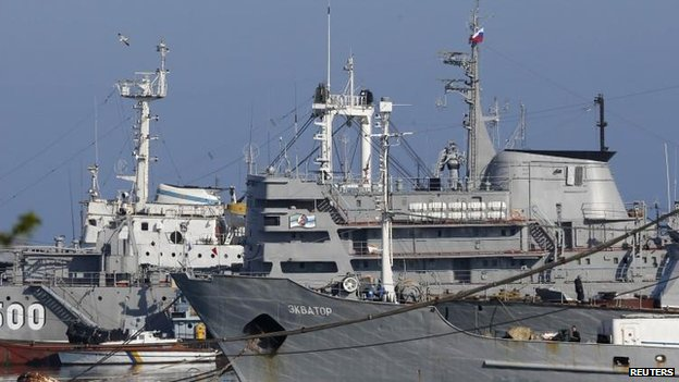 A Russian flag flies on a Ukrainian ship moored in the Crimean port of Sevastopol, 21 March