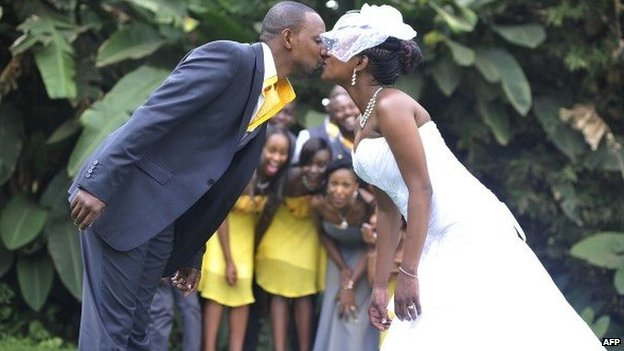 A Kenyan couple kissing at their wedding in Tayana gardens in Nairobi, 3 September 2013