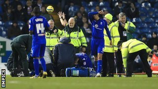 Will Packwood prepares to be loaded onto the stretcher at Elland Road, January 2013