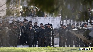 Ukrainian soldiers stand inside a military base in Perevalnoye