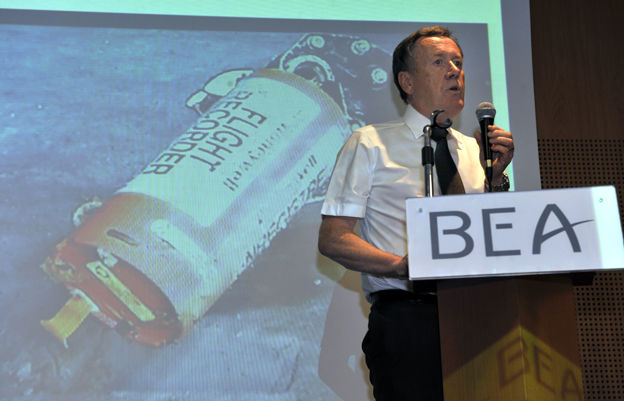 Alain Bouillard, investigator-in-charge of flight Air France 447 safety investigation from French agency Bureau of Enquiry and Analysis for Civil Aviation Safety (BEA), speaks during a press conference focused on the AF447 Rio-Paris plane flight black boxes (screen), on May 12, 2011