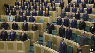 Russian legislators listen to the Russian national anthem after voting in the Russian parliament's upper chamber in Moscow, Russia, Friday, on 21 March 2014.