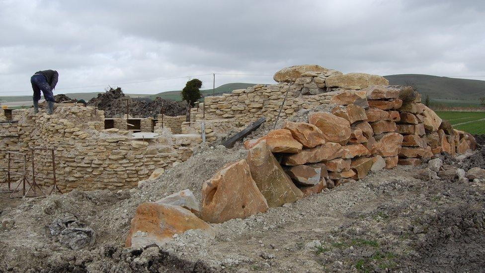 Stonemason working on All Cannings long barrow