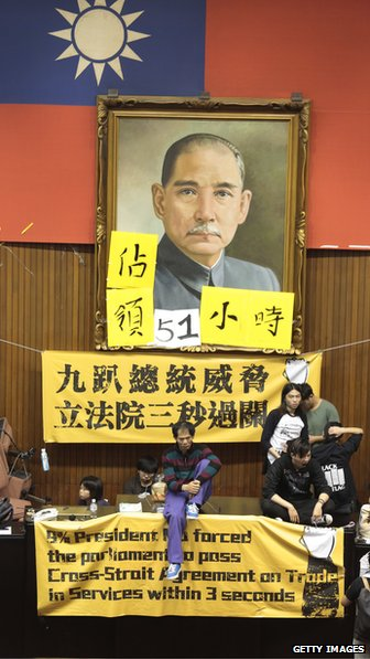 Students sit in from of Sun Yat Sen portrait in Taiwanese parliament