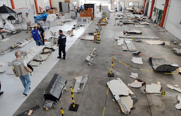 Debris from the Air France crash is laid out in a warehouse