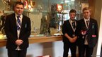 The Stoke Damerel School Report team pose in front of the Exeter Chiefs' trophy cabinet