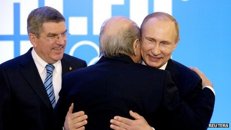 Sepp Blatter embraces Vladimir Putin at the 2014 Winter Olympics