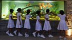 Sri Lankan schoolchildren peer into an aquarium at a park outside Colombo