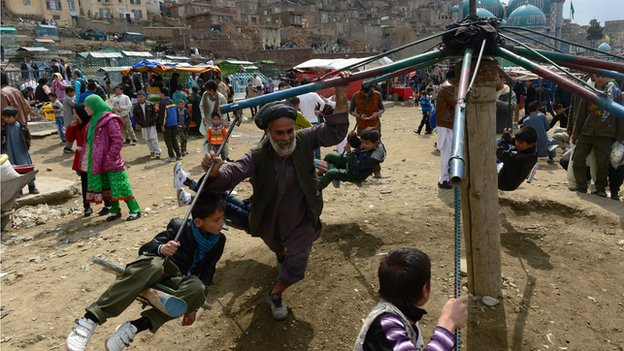 Children play on swings for the Nowruz holiday in Afghanistan