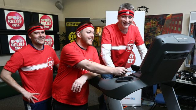 David Healy and Mark Allen offer encouragement as BBC Sport NI presenter Joel Taggart battles to complete his mile for Sport Relief