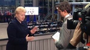 The BBC's Matthew Price (right) speaks to Lithuanian President Dalia Grybauskaite in Brussels