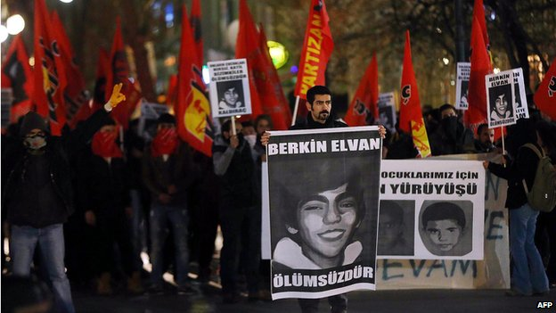 Anti-government protesters in Ankara carry posters bearing the image of Berkin Elvan, 15, who died from injuries sustained in last year's protests (14 March)