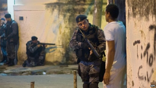 Heavily-armed police patrol a shanty town in Rio de Janeiro, on March 13, 2014