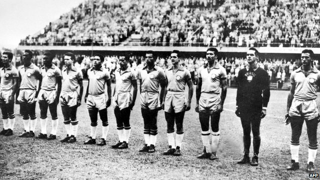 The Brazilian team listens to the national anthem in Sweden on 29 June 1958