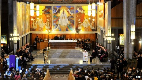 Pope Francis (centre right) attends the service
