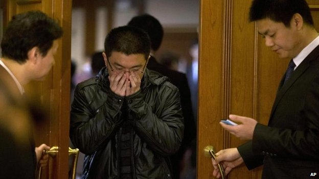 Relatives in Beijing wait for news, 22 March