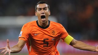 Giovanni van Bronckhorst celebrates after scoring for Netherlands against Uruguay