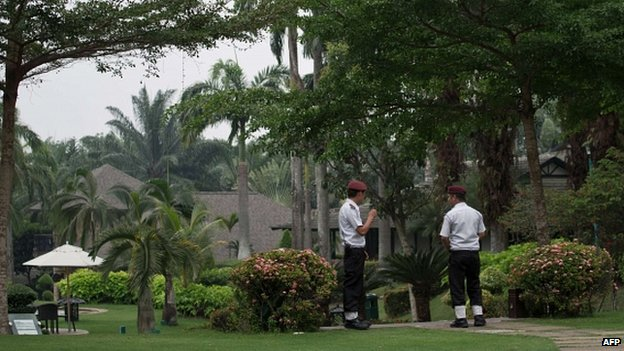 Security guards at entrance to hotel outside Kuala Lumpur where relatives of passengers on flight MH370 are staying
