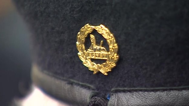 Badge on back of cap
