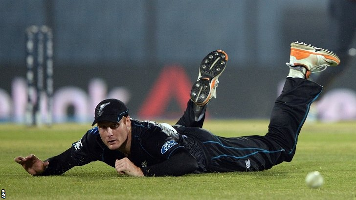 Martin Guptill dives in vain to stop the ball