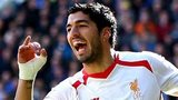 Luis Suarez celebrates at Cardiff