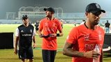 Dejected England players leave the field as rain arrives in Chittagong