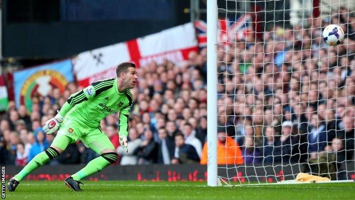 Adrian watches Wayne Rooney's shot go in