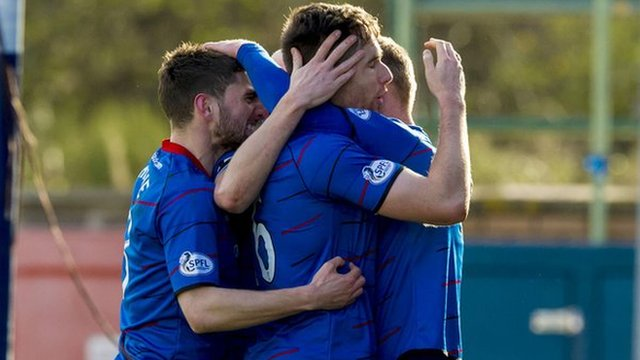 Billy McKay celebrates with his Inverness team-mates after opening the scoring against Partick Thistle