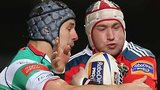 Munster's Johne Murphy is challenged