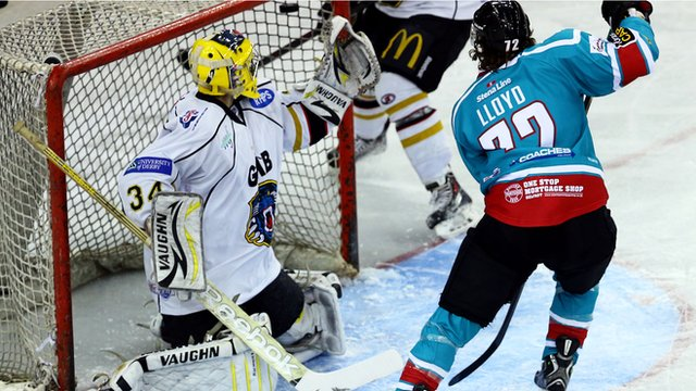 Darryl Lloyd of the Belfast Giants scores against Dan Green of the Nottingham Panthers