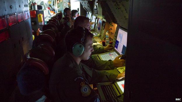 P3 crew members analyse data