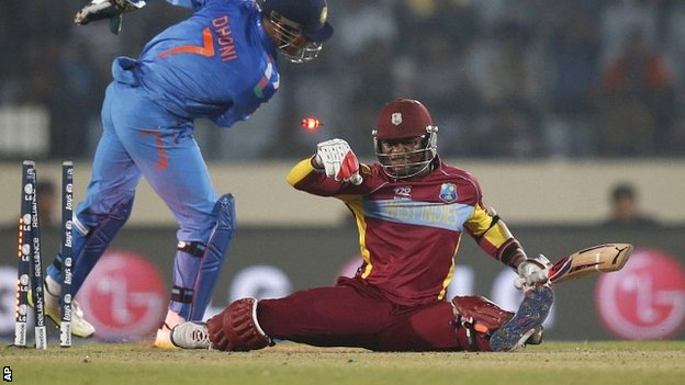 Marlon Samuels is stumped by India captain Mahendra Dhoni