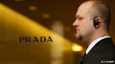 Prada sign and security man