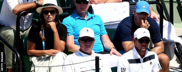 Ivan Lendl (centre) watches along with Kim Sears (left)